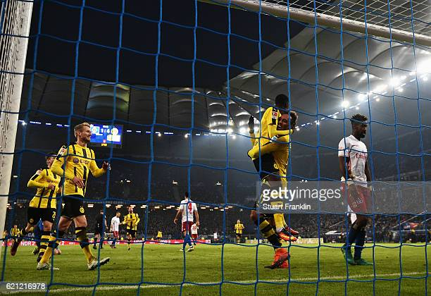 Dembele celebrates scoring the fifth goal with PierreEmerick Aubameyang of Dortmund during the Bundesliga match between Hamburger SV and Borussia...