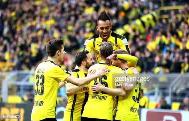 Dembele of Dortmund celebrate with his team mates after he scores the opening goal during the Bundesliga match between Borussia Dortmund and Bayer 04...
