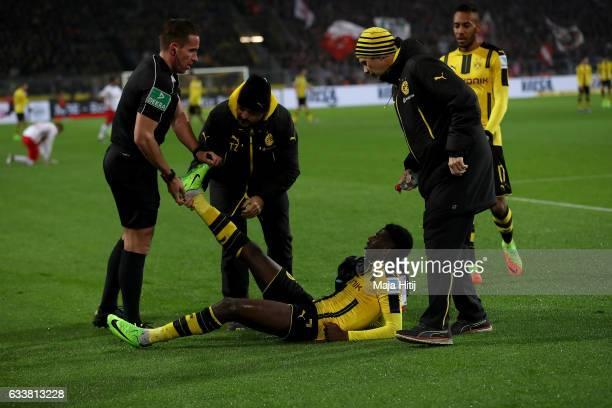 Dembele of Dortmund gets medical treatment during the Bundesliga match between Borussia Dortmund and RB Leipzig at Signal Iduna Park on February 4...