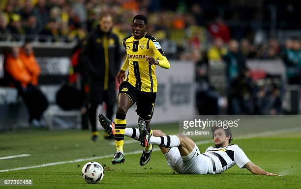Dembele of Dortmund is challenged by Tobias Strobl of Borussia Moenchengladbach during the Bundesliga match between Borussia Dortmund and Borussia...
