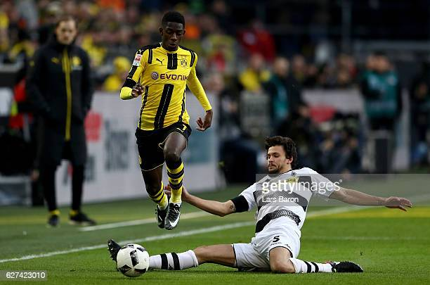 Dembele of Dortmund is challenged by Tobias Strobl of Borussia Moenchengladbach during the Bundesliga match between Borussia Dortmund and Borussia...