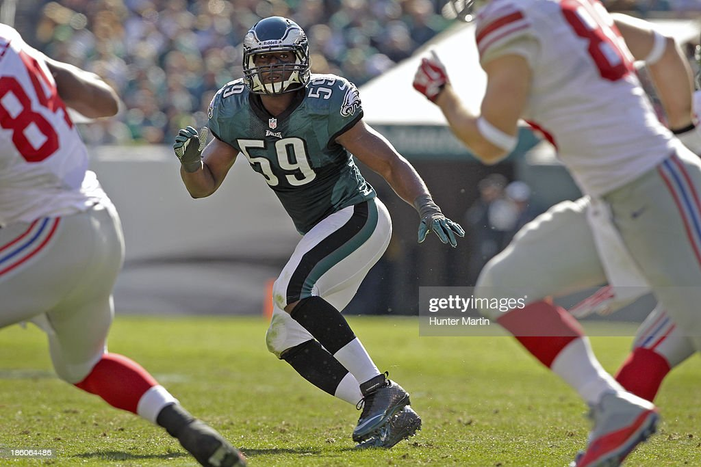 <a gi-track='captionPersonalityLinkClicked' href=/galleries/search?phrase=DeMeco+Ryans&family=editorial&specificpeople=614722 ng-click='$event.stopPropagation()'>DeMeco Ryans</a> #59 of the Philadelphia Eagles drops back into pass coverage during a game against the New York Giants on October 27, 2013 at Lincoln Financial Field in Philadelphia, Pennsylvania. The Giants won 15-7.