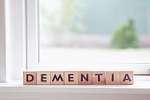 Dementia sign in a window in a bright room