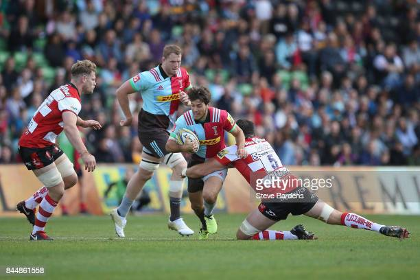 Demetri Catrakilis of Harlequins is tackled by Jeremy Thrush of Gloucester Rugby during the Aviva Premiership match between Harlequins and Gloucester...