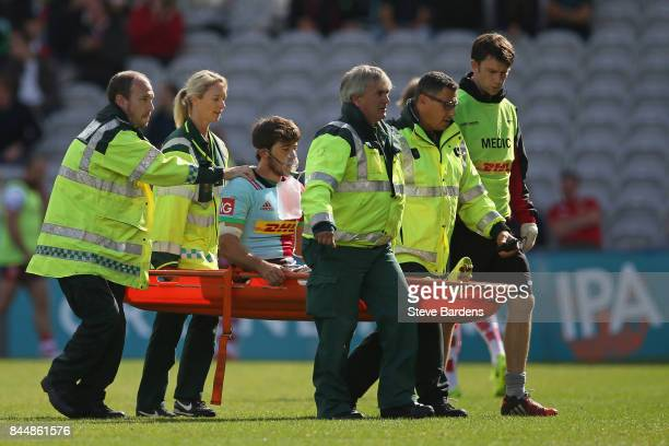 Demetri Catrakilis of Harlequins leaves the field after getting an injury during the Aviva Premiership match between Harlequins and Gloucester Rugby...