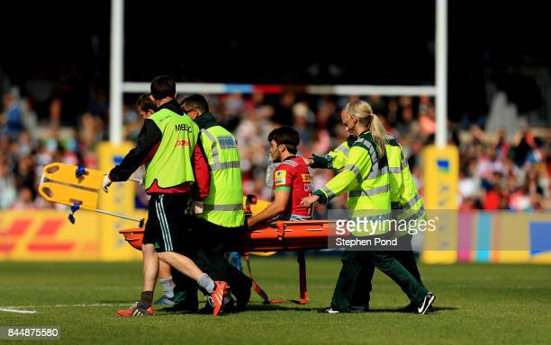 Demetri Catrakilis of Harlequins leaves the field injured during the Aviva Premiership match between Harlequins and Gloucester Rugby at Twickenham...