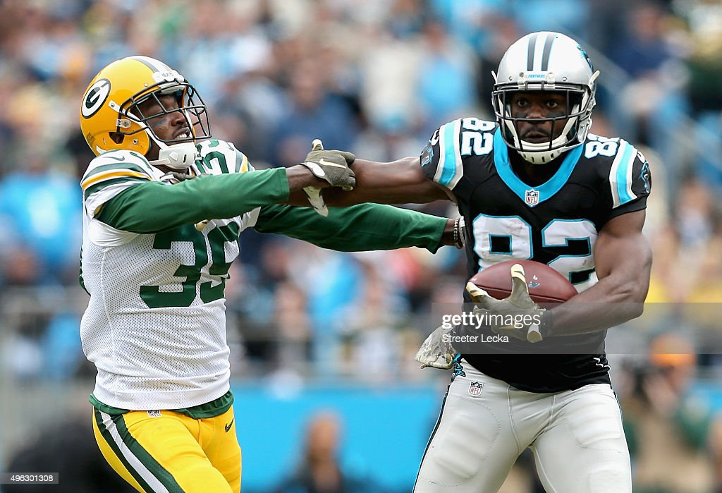 Demetri Goodson #39 of the Green Bay Packers tries to tackle Jerricho Cotchery #82 of the Carolina Panthers during their game at Bank of America Stadium on November 8, 2015 in Charlotte, North Carolina.