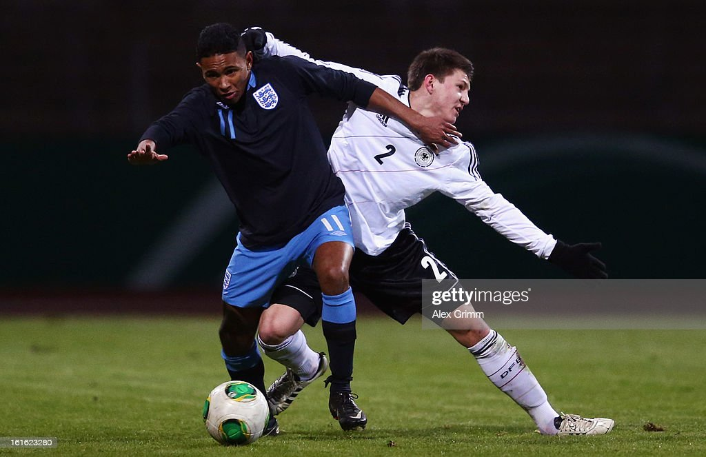 Demetri Mitchell 8front) of England is challenged by Robin Tim Becker of Germany during the U16 international friendly match between Germany and England at Suedstadion on February 13, 2013 in Cologne, Germany.