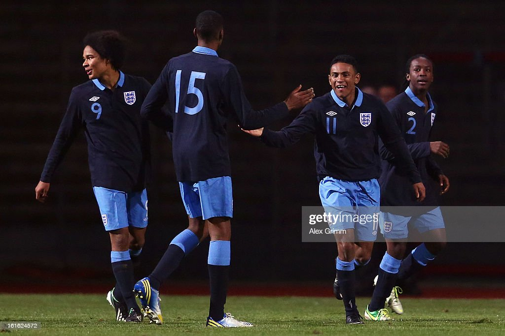 Demetri Mitchell (2R) of England celebrates his team's second goal with team mates during the U16 international friendly match between Germany and England at Suedstadion on February 13, 2013 in Cologne, Germany.