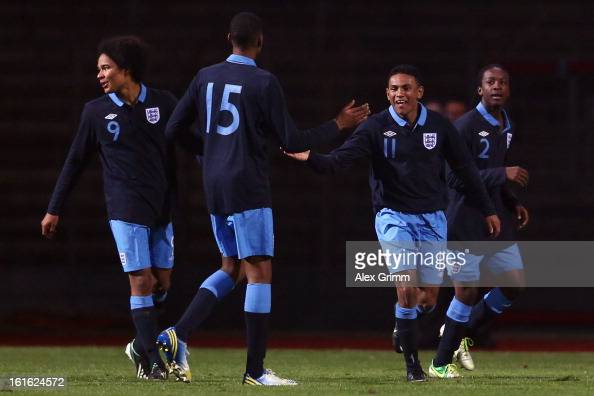 Demetri Mitchell of England celebrates his team's second goal with team mates during the U16 international friendly match between Germany and England...