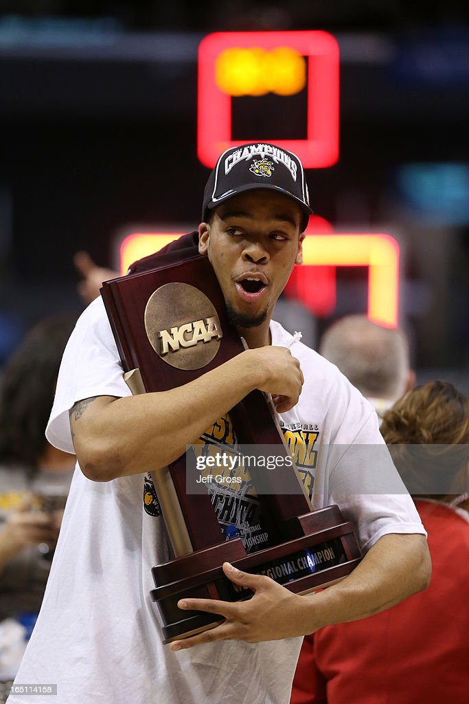 Demetric Williams #5 of the Wichita State Shockers holds on to the West Regional Trophy after defeating the Ohio State Buckeyes 70-66 during the West Regional Final of the 2013 NCAA Men's Basketball Tournament at Staples Center on March 30, 2013 in Los Angeles, California.