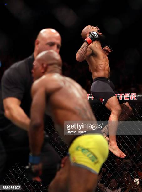Demetrious Johnson celebrates after defeating Wilson Reis to win their Flyweight Championship bout on UFC Fight Night at the Sprint Center on April...