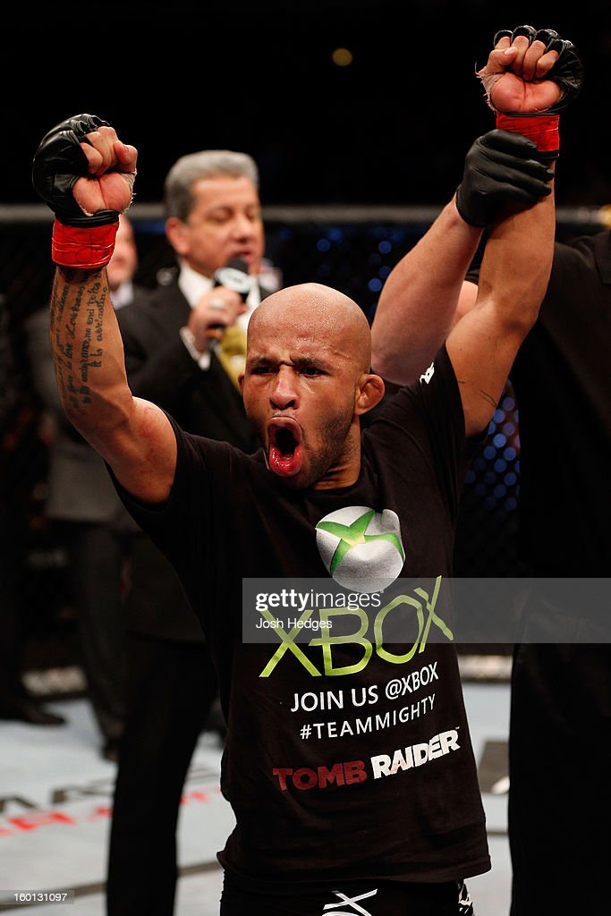 Demetrious Johnson celebrates defeating John Dodson during thier Flyweight Championship Bout part of UFC on FOX at United Center on January 26, 2013 in Chicago, Illinois.