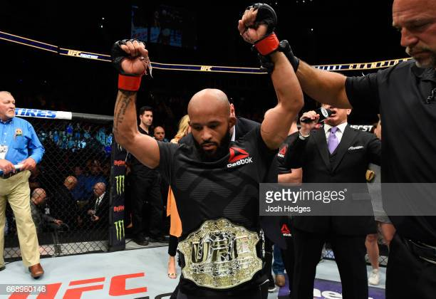Demetrious Johnson celebrates his submission victory over Wilson Reis of Brazil in their UFC flyweight fight during the UFC Fight Night event at...