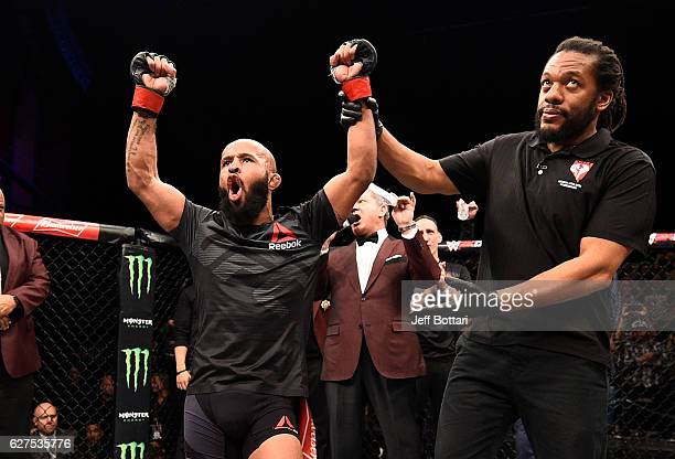 Demetrious Johnson celebrates his unanimousdecision victory over Timothy Elliott in their flyweight championship bout during The Ultimate Fighter...