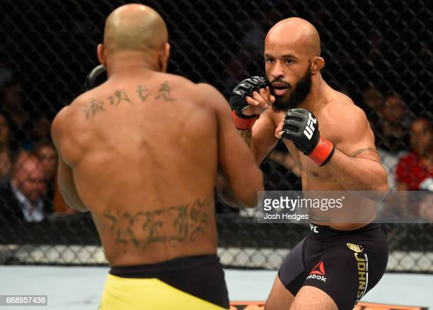 Demetrious Johnson circles Wilson Reis of Brazil in their UFC flyweight fight during the UFC Fight Night event at Sprint Center on April 15 2017 in...