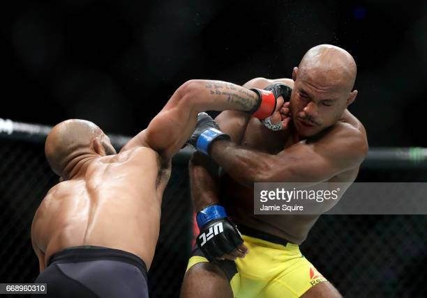 Demetrious Johnson connects with the face of Wilson Reis during their Flyweight Championship bout on UFC Fight Night at the Sprint Center on April 15...