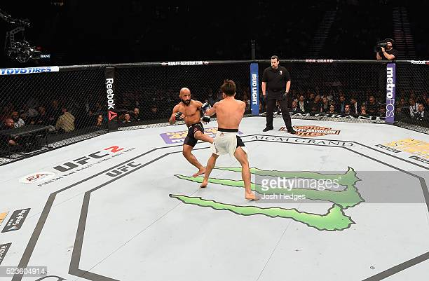 Demetrious Johnson kicks Henry Cejudo in their flyweight championship bout during the UFC 197 event inside MGM Grand Garden Arena on April 23 2016 in...