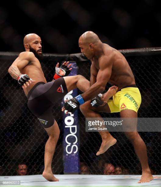 Demetrious Johnson kicks Wilson Reis during their Flyweight Championship bout on UFC Fight Night at the Sprint Center on April 15 2017 in Kansas City...