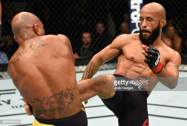 Demetrious Johnson kicks Wilson Reis of Brazil in their UFC flyweight fight during the UFC Fight Night event at Sprint Center on April 15 2017 in...