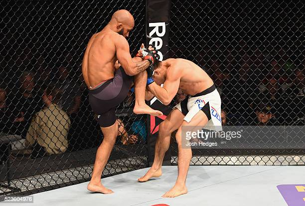 Demetrious Johnson knees Henry Cejudo in their flyweight championship bout during the UFC 197 event inside MGM Grand Garden Arena on April 23 2016 in...