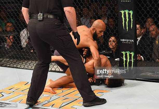Demetrious Johnson punches Henry Cejudo in their flyweight championship bout during the UFC 197 event inside MGM Grand Garden Arena on April 23 2016...