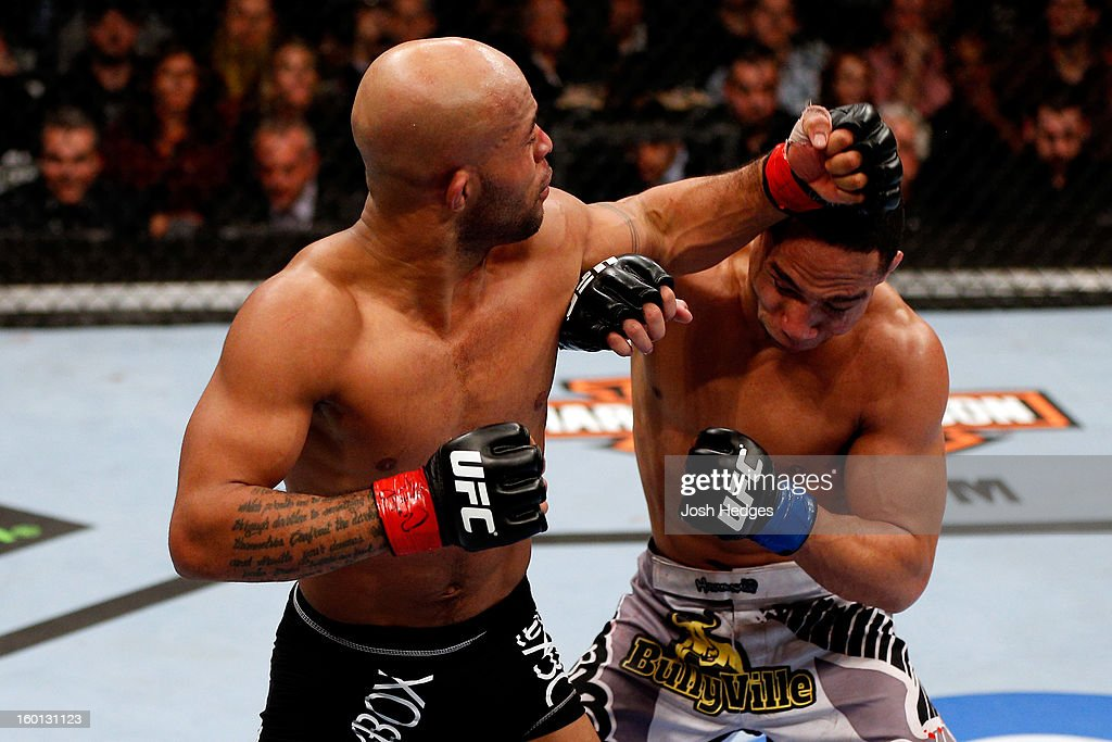 Demetrious Johnson (L) punches John Dodson (R) during thier Flyweight Championship Bout part of UFC on FOX at United Center on January 26, 2013 in Chicago, Illinois.