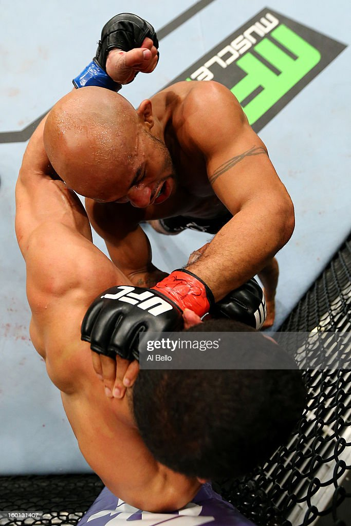 Demetrious Johnson (Top) punches John Dodson (Bottom) during thier Flyweight Championship Bout part of UFC on FOX at United Center on January 26, 2013 in Chicago, Illinois.