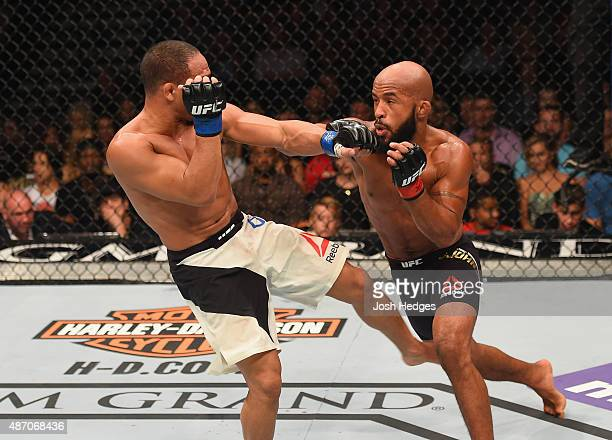 Demetrious Johnson punches John Dodson in their flyweight championship bout during the UFC 191 event inside MGM Grand Garden Arena on September 5...