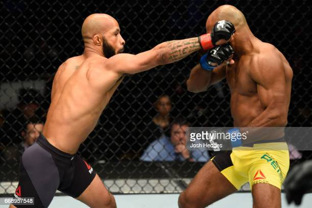 Demetrious Johnson punches Wilson Reis of Brazil in their UFC flyweight fight during the UFC Fight Night event at Sprint Center on April 15 2017 in...