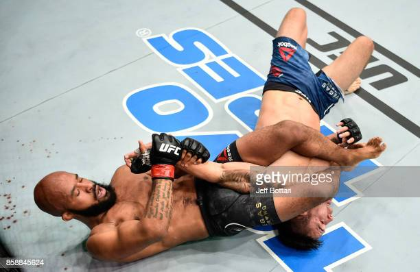 Demetrious Johnson secures an arm bar submission against Ray Borg in their UFC flyweight championship bout during the UFC 216 event inside TMobile...