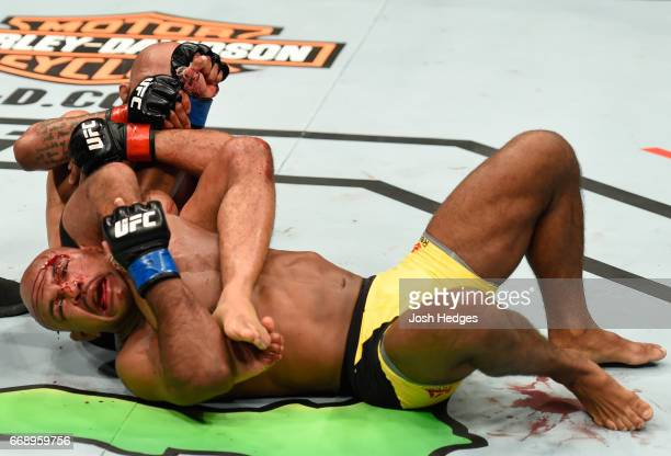 Demetrious Johnson submits Wilson Reis of Brazil in their UFC flyweight fight during the UFC Fight Night event at Sprint Center on April 15 2017 in...