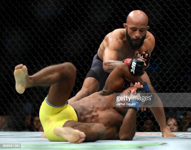 Demetrious Johnson takes down Wilson Reis during their Flyweight Championship bout on UFC Fight Night at the Sprint Center on April 15 2017 in Kansas...