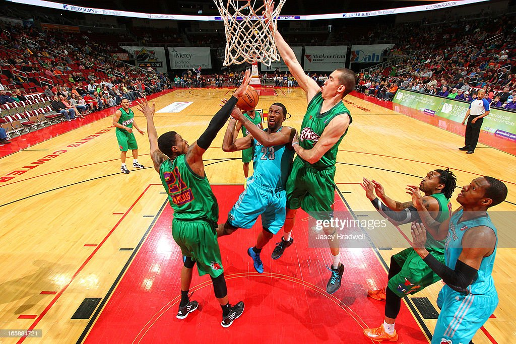 Demetris Nichols #23 of the Sioux Falls Skyforce goes to the basket against Ben Strong #32 and <a gi-track='captionPersonalityLinkClicked' href=/galleries/search?phrase=Jarrid+Famous&family=editorial&specificpeople=6525908 ng-click='$event.stopPropagation()'>Jarrid Famous</a> #21 of the Iowa Energy in an NBA D-League game on April 6, 2013 at the Wells Fargo Arena in Des Moines, Iowa.