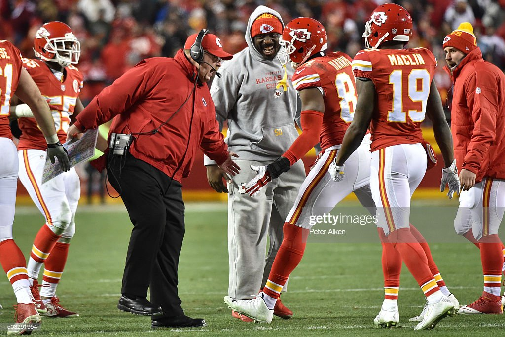 Demetrius Harris of the Kansas City Chiefs is congratulated by head coach Andy Reid after a touchdown catch at Arrowhead Stadium during the third...