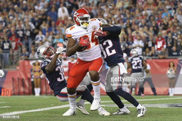 Demetrius Harris of the Kansas City Chiefs makes a touchdown reception during the first quarter against Duron Harmon and Devin McCourty of the New...