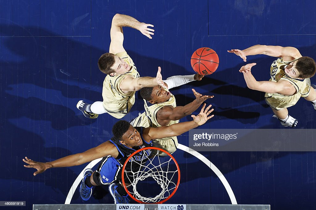 Demetrius Jackson #23 and Pat Connaughton #24 of the Notre Dame Fighting Irish rebound over <a gi-track='captionPersonalityLinkClicked' href=/galleries/search?phrase=Jabari+Parker&family=editorial&specificpeople=9330340 ng-click='$event.stopPropagation()'>Jabari Parker</a> #1 of the Duke Blue Devils during the game at Purcell Pavilion at the Joyce Center on January 4, 2014 in South Bend, Indiana. Notre Dame won 79-77.