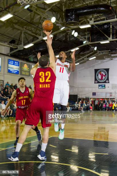 Demetrius Jackson of the Maine Red Claws shoots over Georges Niang of the Ft Wayne Mad Ants in Game 3 of their first round playoff series on...