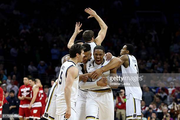 Demetrius Jackson of the Notre Dame Fighting Irish celebrate with his teammates after defeating the Wisconsin Badgers with a score of 56 to 61 during...