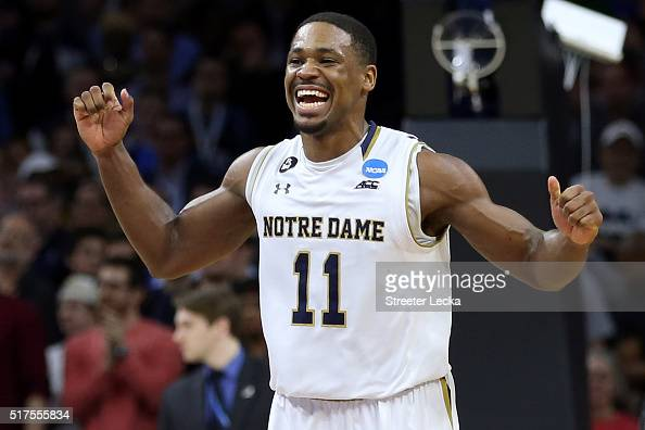 Demetrius Jackson of the Notre Dame Fighting Irish celebrates after defeating the Wisconsin Badgers with a score of 56 to 61 during the 2016 NCAA...