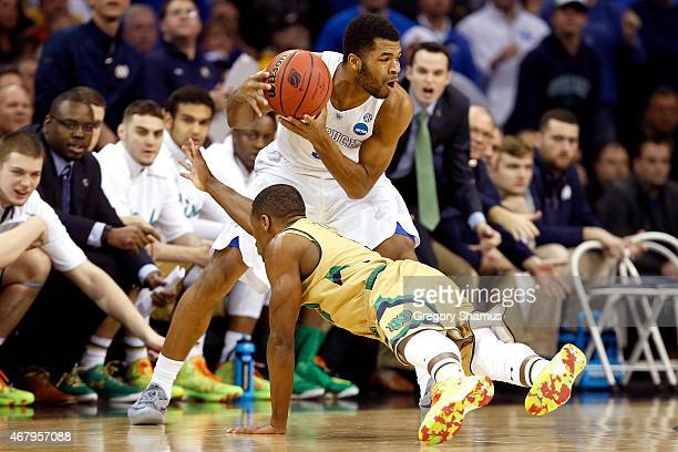 Demetrius Jackson of the Notre Dame Fighting Irish dives for the ball against Andrew Harrison of the Kentucky Wildcats in the first half during the...