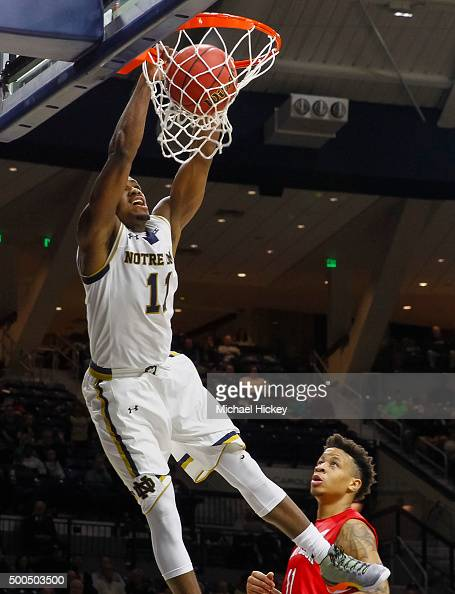 Demetrius Jackson of the Notre Dame Fighting Irish goes up for the dunk as Rayshaun McGrew of the Stony Brook Seawolves looks on at Purcell Pavilion...