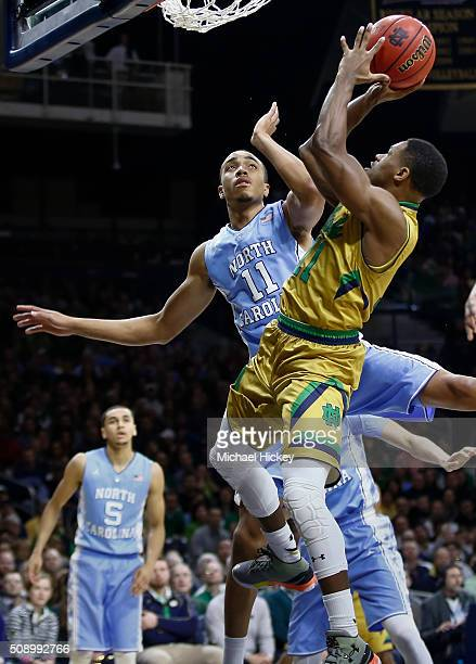 Demetrius Jackson of the Notre Dame Fighting Irish shoots the ball against Brice Johnson of the North Carolina Tar Heels at Purcell Pavilion on...