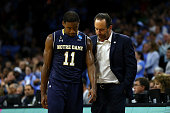 Demetrius Jackson of the Notre Dame Fighting Irish talks with head coach Mike Brey late in the second half against the North Carolina Tar Heels...