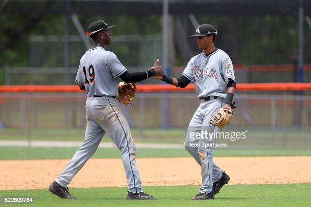 Demetrius Sims of the Marlins congratulates second baseman Gerardo Nunez once the game ended after the Gulf Coast League game between the Marlins and...