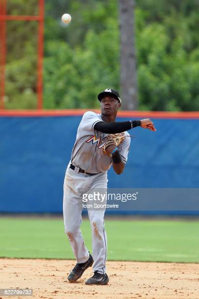 Demetrius Sims of the Marlins fields a ground ball and then throws the ball over to first base during the Gulf Coast League game between the Marlins...
