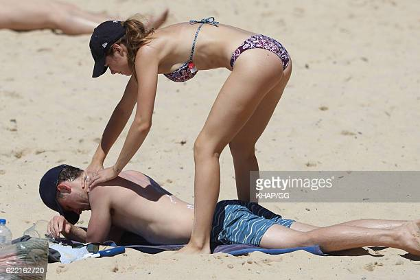 Demi Harman pictured with partner Alec Snow enjoying a beach outing on October 15 2016 in Sydney Australia