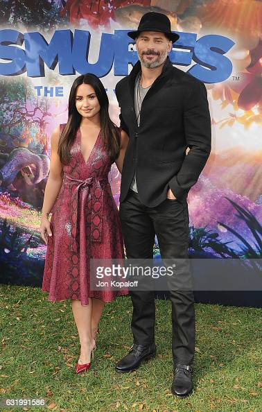 Demi Lovato and Joe Manganiello pose at the Photo Call For Sony Pictures Releasing's 'Smurfs The Lost Village' at Sony Pictures Studios on January 18...