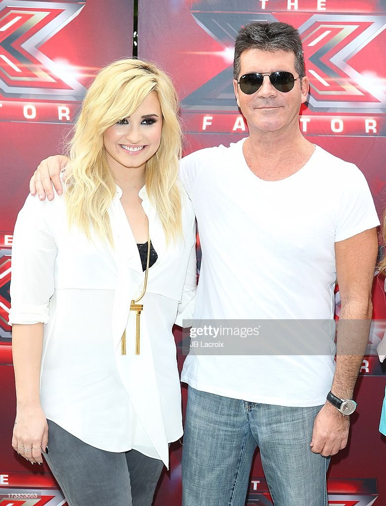 Demi Lovato and Simon Cowell attend Fox's 'The X Factor' Judges at Galen Center on July 11, 2013 in Los Angeles, California.