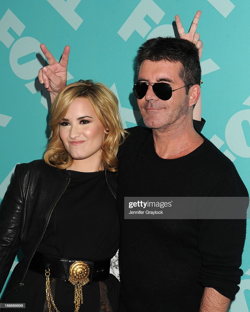 Demi Lovato and Simon Cowell attend the FOX 2103 Programming Presentation Post-Party at Wollman Rink in Central Park on May 13, 2013 in New York City.